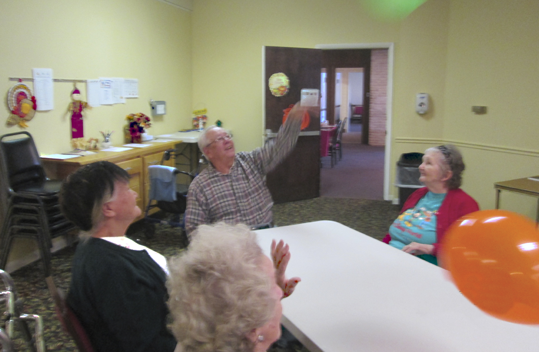 Residents Playing with a Balloon